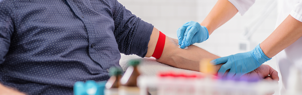 man getting blood drawn in lab