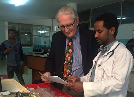 Dr. Koning in Ethiopia talking to another health care professional