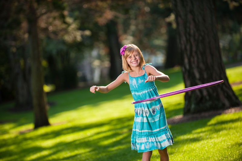 little girl with a hula hoop